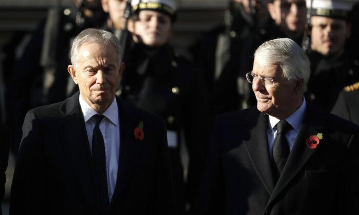 Former British Prime Ministers Tony Blair (L) and John Major in London on Nov. 10, 2019.  (Matt Dunham/AP Photo)