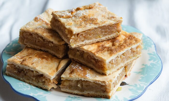 Placinte come with a variety of doughs and fillings, both savory and sweet, but perhaps most beloved of all is placinta cu mere: made with grated, spiced, and stewed apples, and a soft dough enriched with sour cream. (Irina Georgescu)