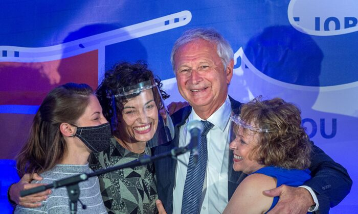 Premier Blaine Higgs embraces his wife and daughters after winning the New Brunswick provincial election, in Quispamsis, N.B., on Sept. 14, 2020. (The Canadian Press/Andrew Vaughan)