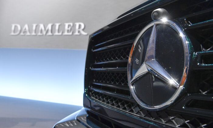 The Mercedes-Benz star is displayed on the front of a Mercedes-Benz G-model at the annual press conference of German auto giant Daimler AG in Stuttgart, southwestern Germany, on Feb. 1, 2018. (Thomas Kienzle/AFP via Getty Images)