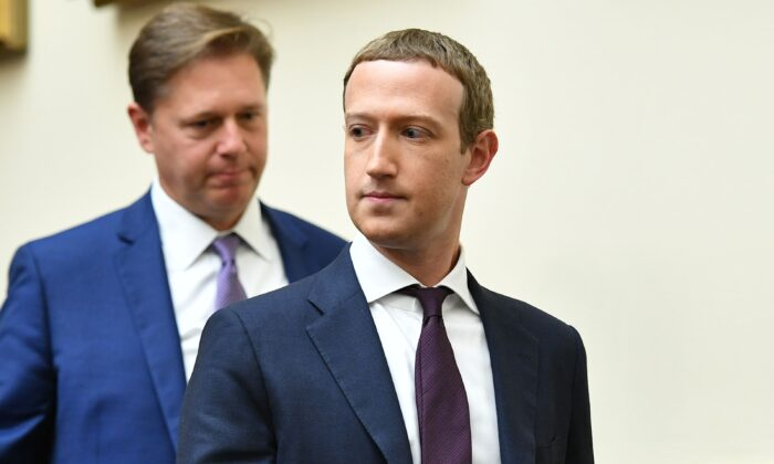 """Facebook Chairman and CEO Mark Zuckerberg returns from a recess as he testifies before the House Financial Services Committee on """"An Examination of Facebook and Its Impact on the Financial Services and Housing Sectors"""" in the Rayburn House Office Building in Washington on Oct. 23, 2019. (Mandel Ngan/AFP via Getty Images)"""