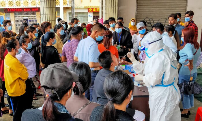Residents are tested for COVID-19 in Ruili in southwestern China's Yunnan Province on September 15, 2020. (STR/AFP via Getty Images)