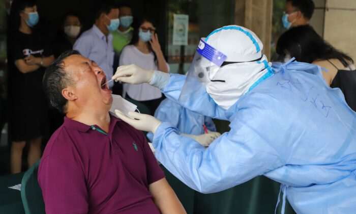 A resident is tested for COVID-19 in Ruili, in southwestern China's Yunnan Province, on Sept. 15, 2020. (STR/AFP via Getty Images)