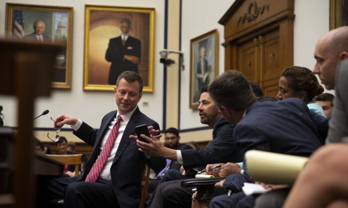 Then-FBI official Peter Strzok confers with his legal counsel before a joint committee hearing on Capitol Hill in Washington on July 12, 2018.   Alex Edelman/Getty Images