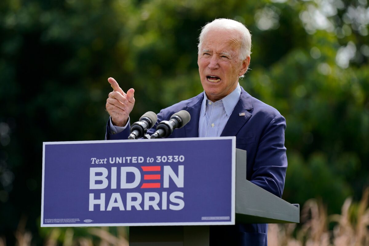 Biden Transition Team Suggests Balancing Act Between Centrists,...