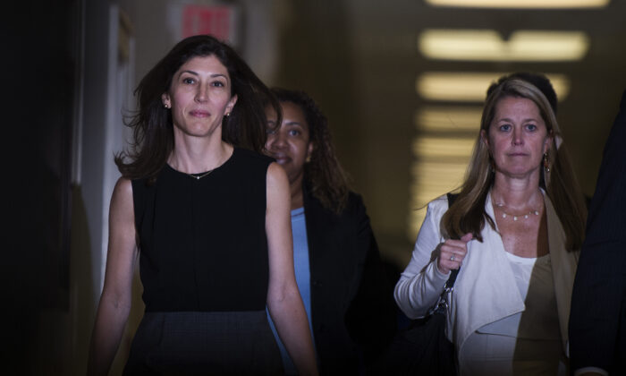 Lisa Page, former legal counsel to former FBI Director Andrew McCabe, arrives on Capitol Hill in Washington on July 13, 2018. (Andrew Caballero-Reynolds/AFP via Getty Images)