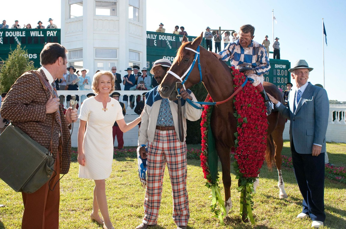 """6 people, 1 horse covered with rose garland in """"Secretariat"""""""