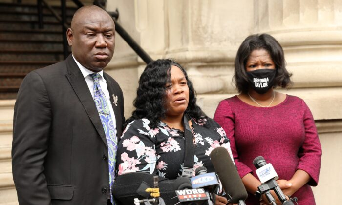 Breonna Taylor's mother Tamika Palmer, center, addresses the media over the speed of the investigation of her daughter's death as attorney Benjamin Crump, left, and co-counsel Lonita Baker look on outside Louisville City Hall in Louisville, Ky., on Aug. 13, 2020. (John Sommers II/Getty Images)