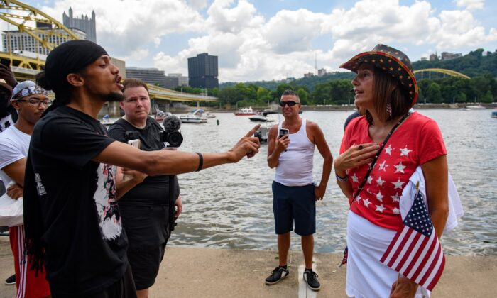 Lorenzo Rulli, 24, a Black Lives Matter activist, and a supporter of President Donald Trump (R) exchange words in Pittsburgh, Penn., on July 4, 2020. (Jeff Swensen/Getty Images)