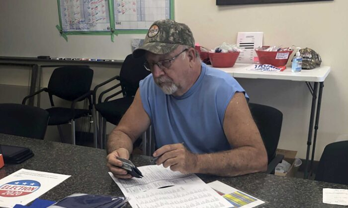 Ken Miller fills out the state election form to change his voter registration from Democrat to Republican. (Salena Zito)