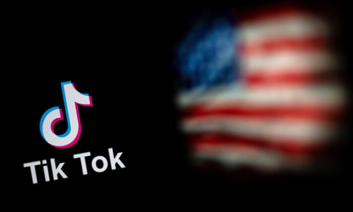 The logo of the social network application TikTok (L) and a US flag (R) shown on the screens of two laptops in Beijing, China, on Sept. 14, 2020. (Nicolas Asfouri/AFP via Getty Images)
