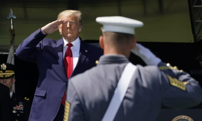 President Donald Trump salutes as he arrives at the 2020 U.S. Military Academy graduation ceremony in West Point, New York, on June 13, 2020. (Timothy A. Clary/AFP via Getty Images)