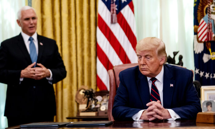 Vice President Mike Pence speaks as President Donald Trump participates in a signing ceremony and meeting with the President of Serbia Aleksandar Vucic and the Prime Minister of Kosovo Avdullah Hoti in the Oval Office of the White House in Washington on Sept. 4, 2020. (Anna Moneymaker-Pool/Getty Images)