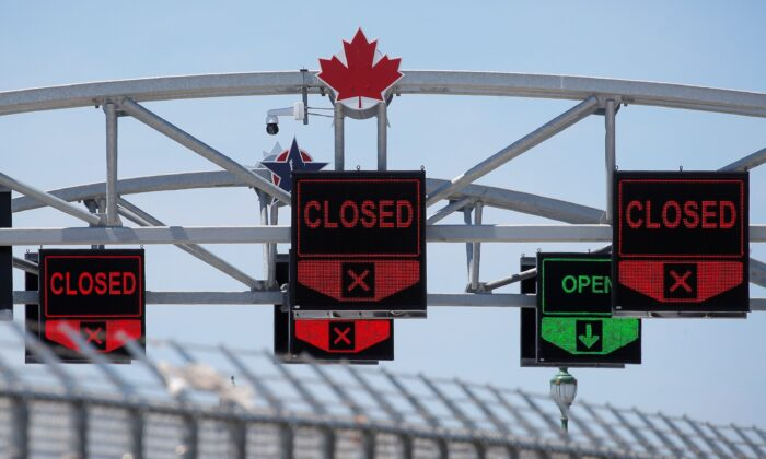 A Canadian maple leaf is seen on The Peace Bridge, which runs between Canada and the United States, over the Niagara River in Buffalo, New York, U.S. on July 15, 2020. (REUTERS/Brendan McDermid)