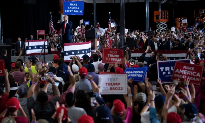People cheer for President Donald Trump after he spoke during an indoor campaign rally at Xtreme Manufacturing in Henderson, a suburb of Las Vegas, Nev., on Sept. 13, 2020. (Brendan Smialowski / AFP via Getty Images)