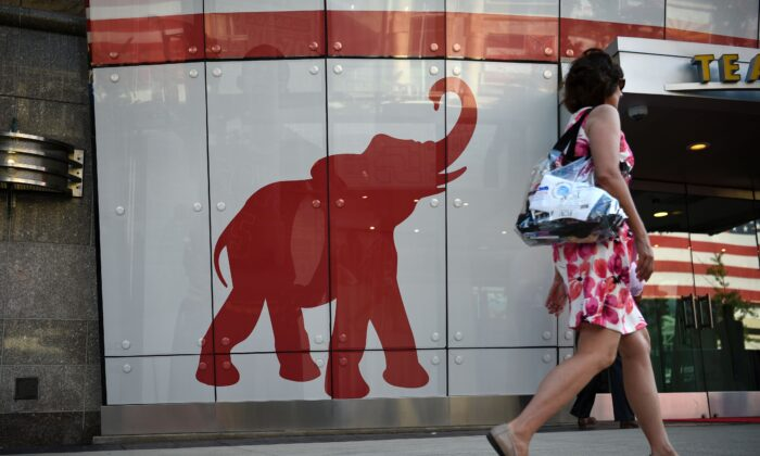 A woman walks past the elephant logo of the Republican Party on the first day of the Republican National Convention in Cleveland, on July 18, 2016. (Dominick Reuter/AFP via Getty Images)