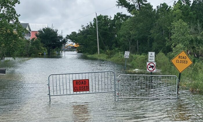 Waters from the Gulf of Mexico, driven by Hurricane Sally, flood this Pass Christian, Miss., street and threaten the homes that line it on Sept. 15, 2020. (Hunter Dawkins/The Gazebo Gazette via AP)