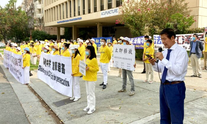 Practitioners of the spiritual discipline Falun Gong gather in front of the Chinese Consulate in Los Angeles to raise awareness of the persecution of Falun Gong in China, on Sept. 13, 2020. (Jack Bradley/The Epoch Times)
