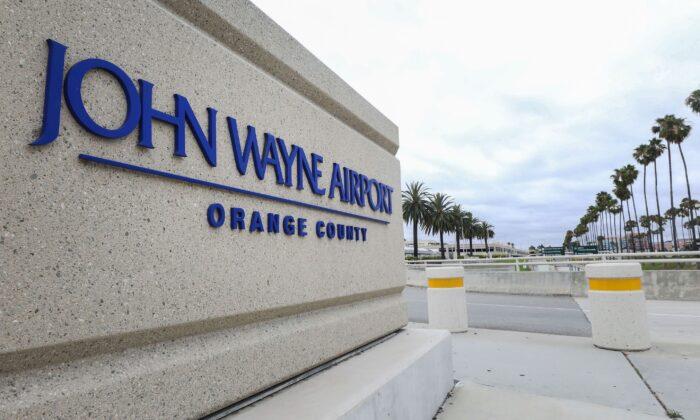 A sign is displayed at John Wayne Airport in Santa Ana, Calif., on June 28, 2020.  (Mario Tama/Getty Images)