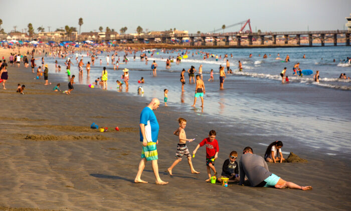 People enjoy the Orange County coast at Seal Beach, Calif., on Sept. 6, 2020. (John Fredricks/The Epoch Times)