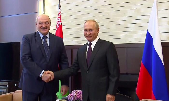 Russia's President Vladimir Putin shakes hands with his Belarusian counterpart Alexander Lukashenko during a meeting in Sochi, Russia, on Sept. 14, 2020. (Russian Presidential Executive Office/Handout via Reuters)