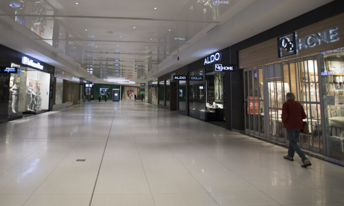 Stores are seen closed in a near-empty shopping mall in West Vancouver on May 13, 2020. Many of the stores are shut down due to the COVID-19 pandemic. (The Canadian Press/Jonathan Hayward)