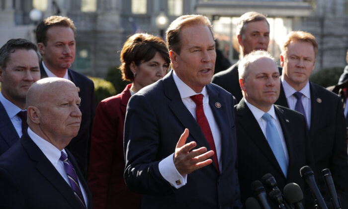 Rep. Vern Buchanan (R-Fla.) (C) is joined by Republican members of the House while talking to reporters outside the White House West Wing in Washington on March 26, 2019. (Chip Somodevilla/Getty Images)