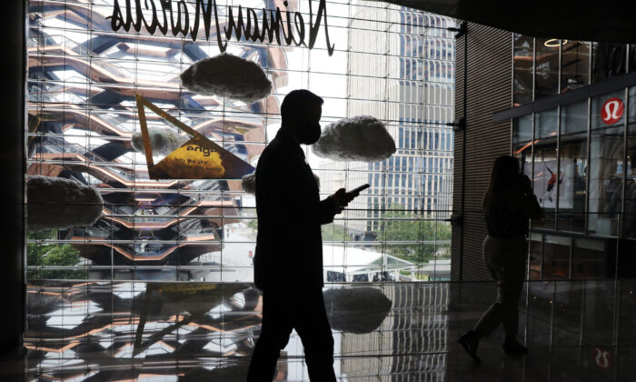 The silhouette of a person holding what seems to be a smartphone is seen in a shopping mall in New York City, on Sept. 09, 2020. (Spencer Platt/Getty Images)