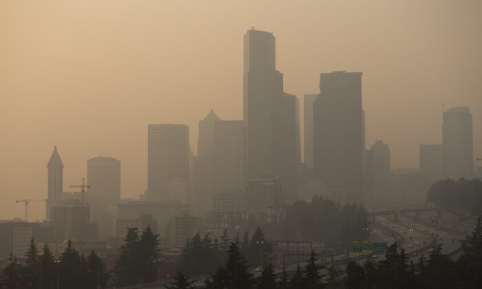 Cars drive on I-5 in front of a hazy Seattle skyline due to wildfire smoke in Seattle, Wash., Sept. 11, 2020. (Lindsey Wasson/Getty Images)
