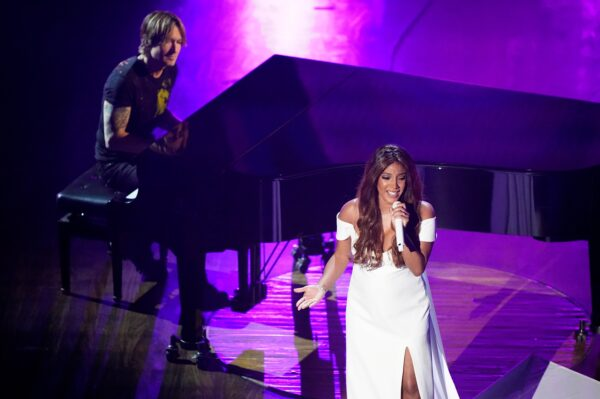 Mickey Guyton and Keith Urban perform