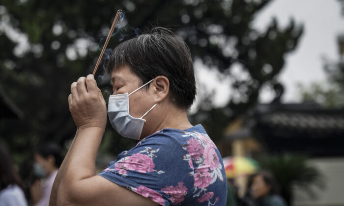 A woman worships at the Guiyuan temple in Wuhan, central China's Hubei Province on Sept. 16 , 2020. (Getty Images)