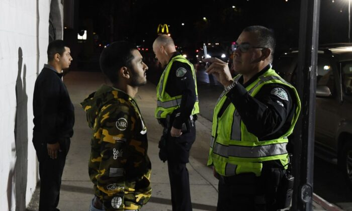 Drivers undergo field sobriety tests at a Los Angeles Police Department DUI checkpoint in Reseda, Calif., on April 13, 2018. (Mark Ralston/AFP via Getty Images)