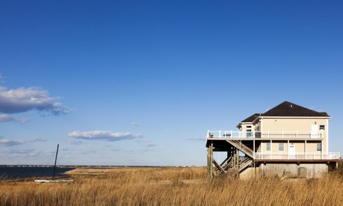 Vacation homes, like this one in the Hamptons, have become a refuge for city dwellers fleeing COVID-19, but the massive migration has overwhelmed services in some of these smaller rural communities. (Michael Rega/Shutterstock)