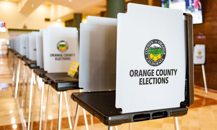 Orange County election stands await voters inside the Honda Center, which has been converted into a polling place, in Anaheim, Calif., on Sept. 16, 2020. (John Fredricks/The Epoch Times)