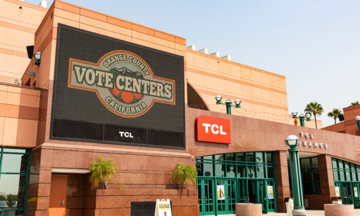 A sign outside the Honda Center announces the arena's temporary transformation into a polling location in Anaheim, Calif., on Sept. 16, 2020. (John Fredricks/The Epoch Times)