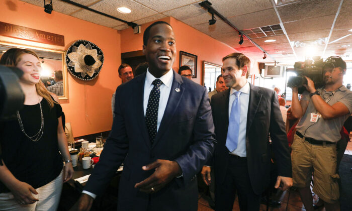 Michigan GOP Senate candidate John James (left) campaigns with the help of Sen. Marco Rubio (R-Fla.) (right) at Senor Lopez Restaurant in Detroit, Mich., on Aug. 13, 2018. (Bill Pugliano/Getty Images)