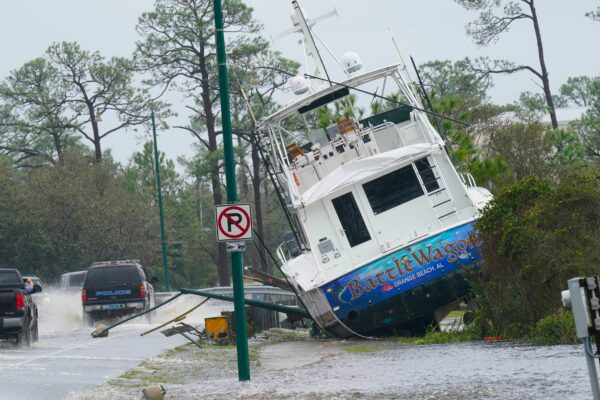 A boat is washed up near a road