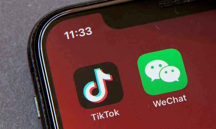 Icons for the smartphone apps TikTok and WeChat are seen on a smartphone screen in Beijing, on Aug. 7, 2020. (Mark Schiefelbein/AP Photo)