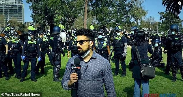 Avi Yemini reporting for Rebel News from a lockdown protest in Melbourne, Australia. (Rebel News)