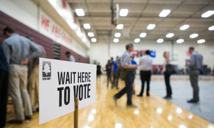 Voters line up to cast their ballots at a polling station set up at Grady High School for the mid-term elections in Atlanta, Ga., on Nov. 6, 2018. (Jessica McGowan/Getty Images)