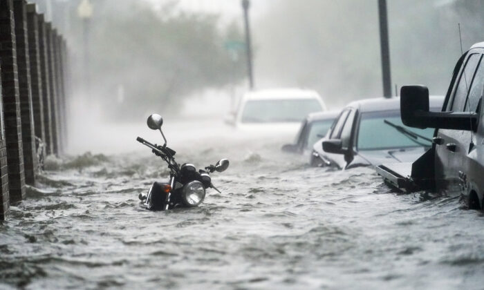 Floodwaters move on the street in Pensacola, Fla.,  on Sept. 16, 2020. (Gerald Herbert/AP)