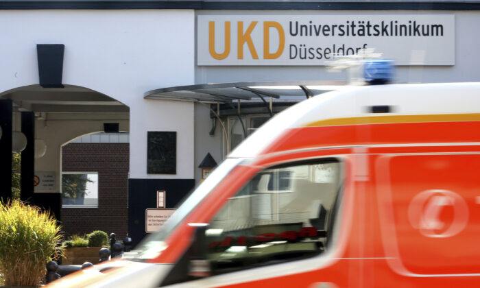 An ambulance drives past the University Hospital in Duesseldorf, Germany, on Sept. 15, 2020. (Roland Weihrauch/dpa via AP)