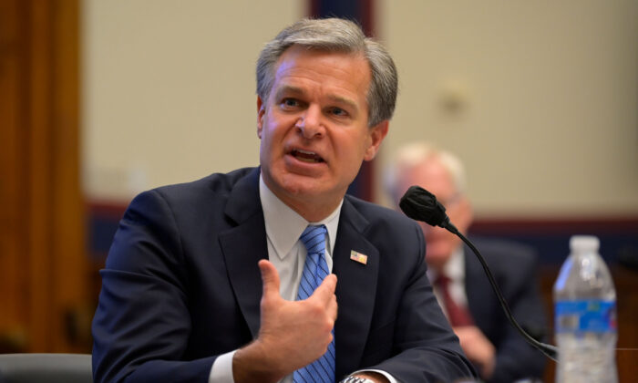 "FBI Director Christopher Wray testifies before a House Homeland Security Committee hearing about ""Worldwide threats to the Homeland"" on Capitol Hill in Washington, on Sept. 17, 2020. (John McDonnell/AFP via Getty Images)"