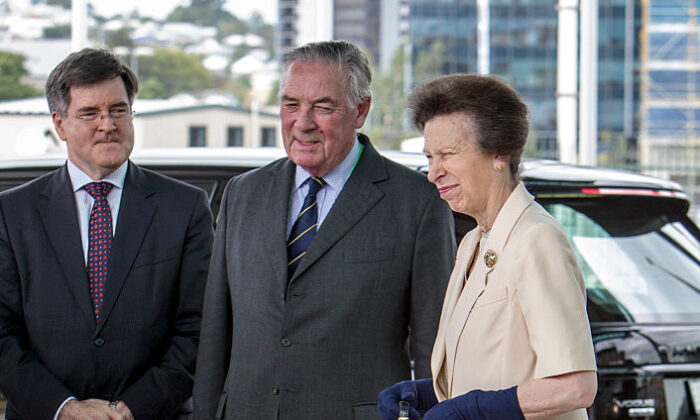 Princess Anne, Princess Royal is greeted by Lord Samuel Vestey (C) and John McVeigh MP (L) as she arrives at the Agricultural Conference at the Royal International Convention Centre on October 21, 2014 in Brisbane, Australia.  (Photo by Glenn Hunt/Getty Images)