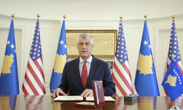 Kosovo's President Hashim Thaci signs the Order of Freedom awarded to U.S. President Donald Trump, in capital Pristina, on Sept. 18, 2020. (Visar Kryeziu/AP Photo)