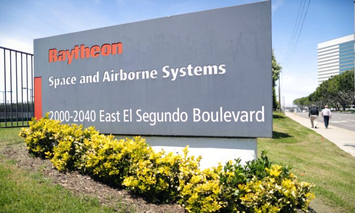A company sign is posted at a Raytheon Co. campus in El Segundo, Calif., on June 10, 2019. (Mario Tama/Getty Images)
