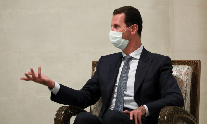 Syrian President Bashar al-Assad gestures while speaking to Russian Foreign Minister Sergey Lavrov during their talks in Damascus, on Sept. 7, 2020 (Russian Foreign Ministry Press Service via AP, File)