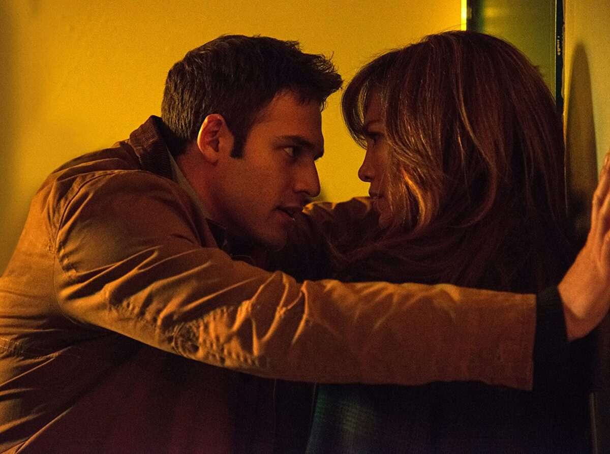 "man menaces woman against wall in ""The Boy Next Door"""