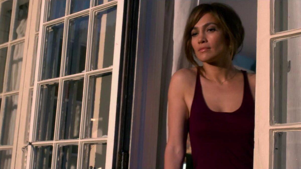 """woman in maroon tank-top in """"The Girl Next Door"""""""