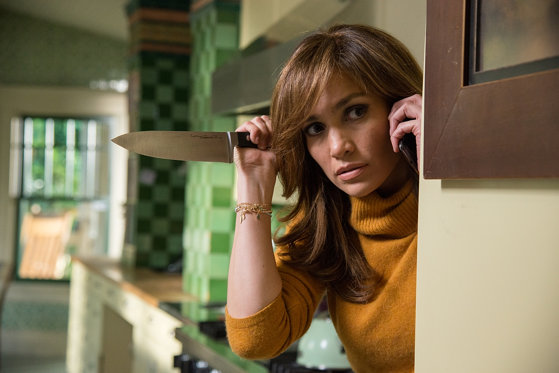 "woman holds butcher knife in ""The Boy Next Door"""